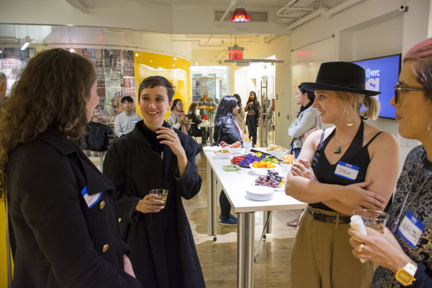 Three DSI students talking at our Open House