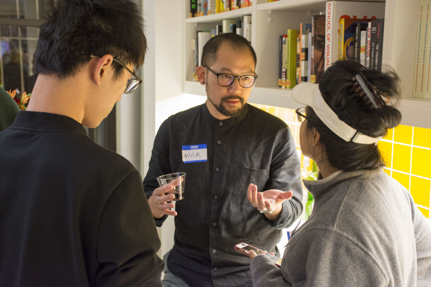Alum Nicholas Chan speaking to guests at our Open House