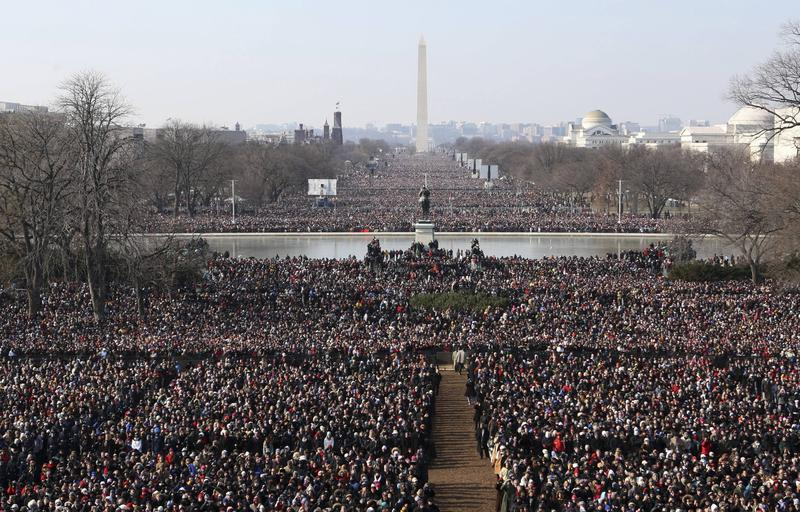 ** FOR USE AS DESIRED, YEAR END PHOTOS ** FILE - Crowds gather to watch the inauguration of President Barack Obama, in this Jan. 20, 2009 file photo, on the west side of the Capitol in Washington. The Washington Monument can be seen in the background. (AP Photo/Scott Andrews, Pool, File)