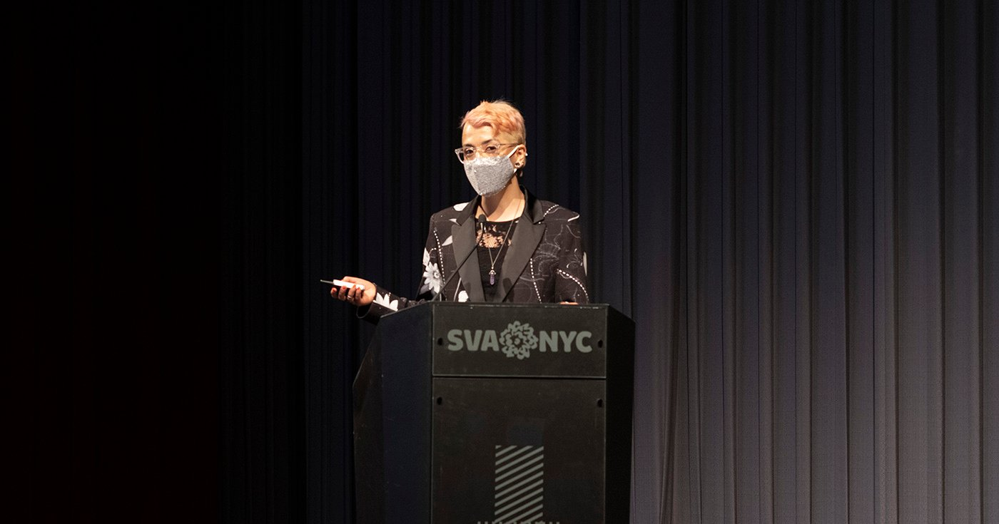 Laura Presenting at DSI Thesis 2021 show behind a podium that reads SVA NYC