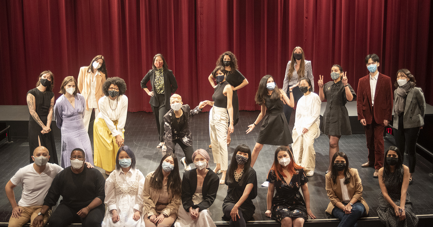 The 2021 Cohort dressed amazingly well on stage at Thesis show 2021. A red curtain is behind them.